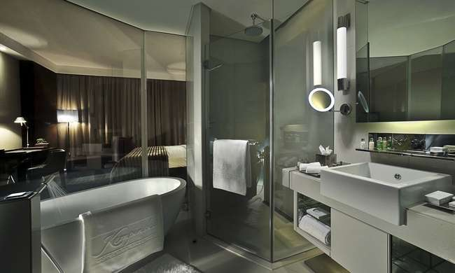 Smart glass shower design smartglass international for What do hotels use to clean bathrooms