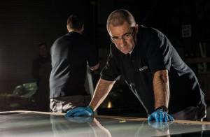 A Smartglass employee testing a panel of switchable glass